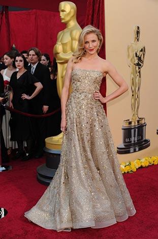 in a glittery Oscar de la Renta gown